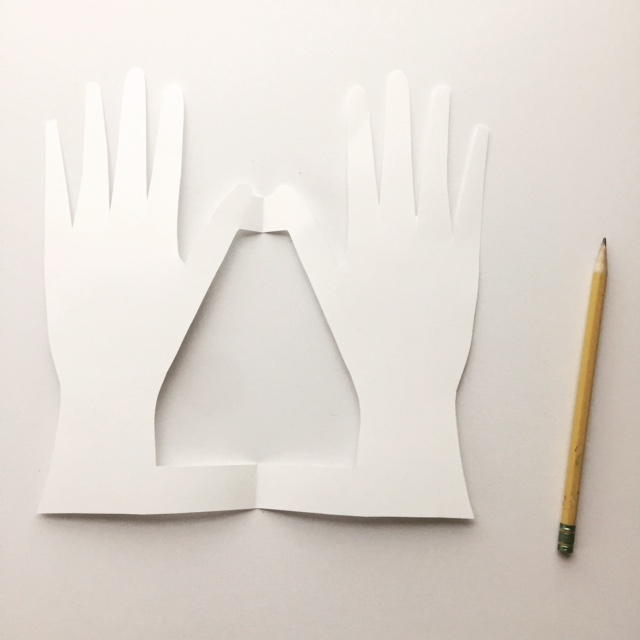 If you want to make your valentine into a folded greeting card you will fold your piece of paper in half and trace your hand shape. When you cut your hands out you will leave two connecting joints--1 at the wrist and 1 at the thumb.