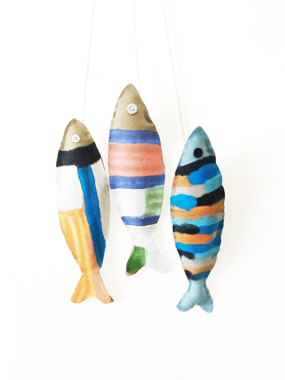Ri's fish. She hand stitched the one on the far right and fabric glued the other two (her hands were tired).