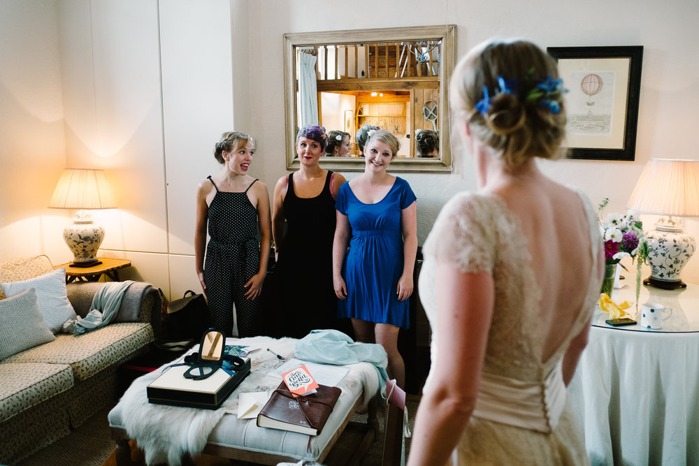 Bridesmaids admiring a bride at Merriscourt Wedding Venue, Oxfordshire