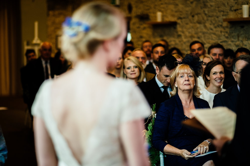 The guests look on at a wedding at Merriscourt Wedding Venue, Oxfordshire