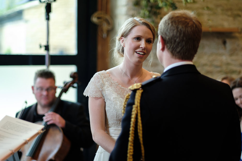 A bride saying her vows at Merriscourt Wedding Venue, Oxfordshire
