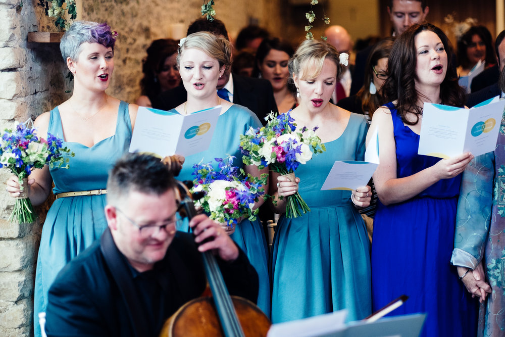 Guests singing at a wedding at Merriscourt Wedding Venue, Oxfordshire