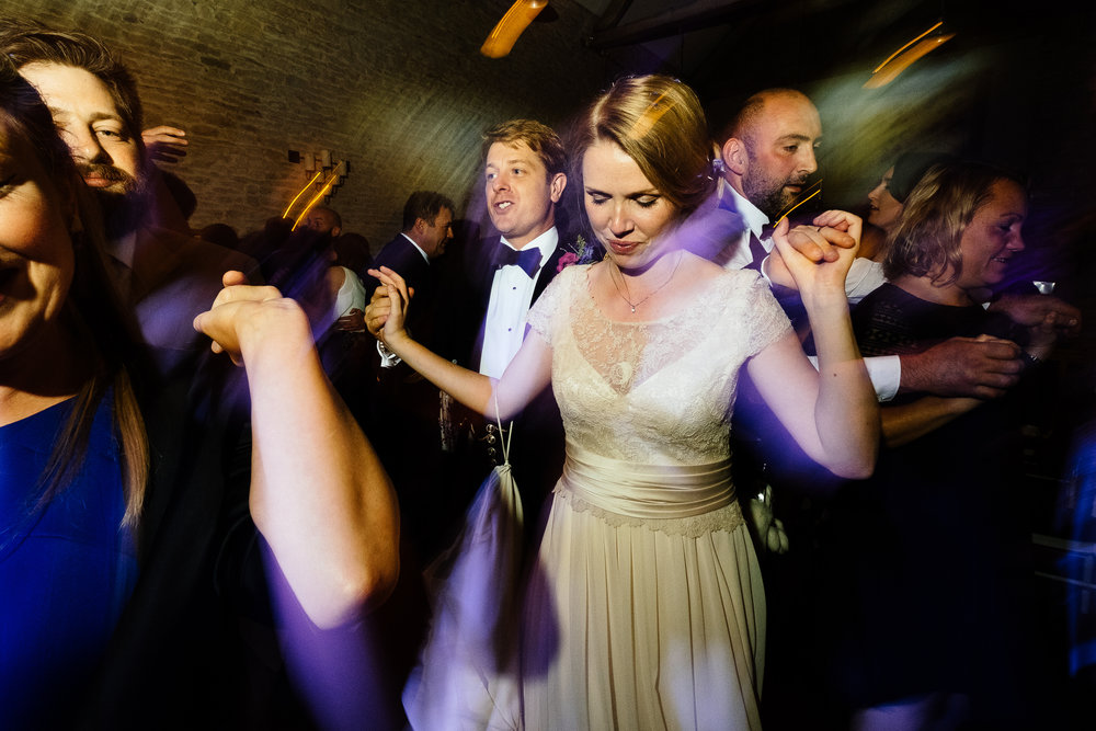 A bride and groom partying at a wedding at Merriscourt Wedding Venue, Oxfordshire