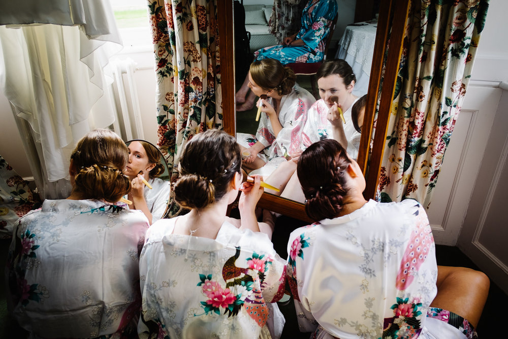 Bridesmaids getting ready at a wedding at Poundon House, Near Bicester Oxfordshire