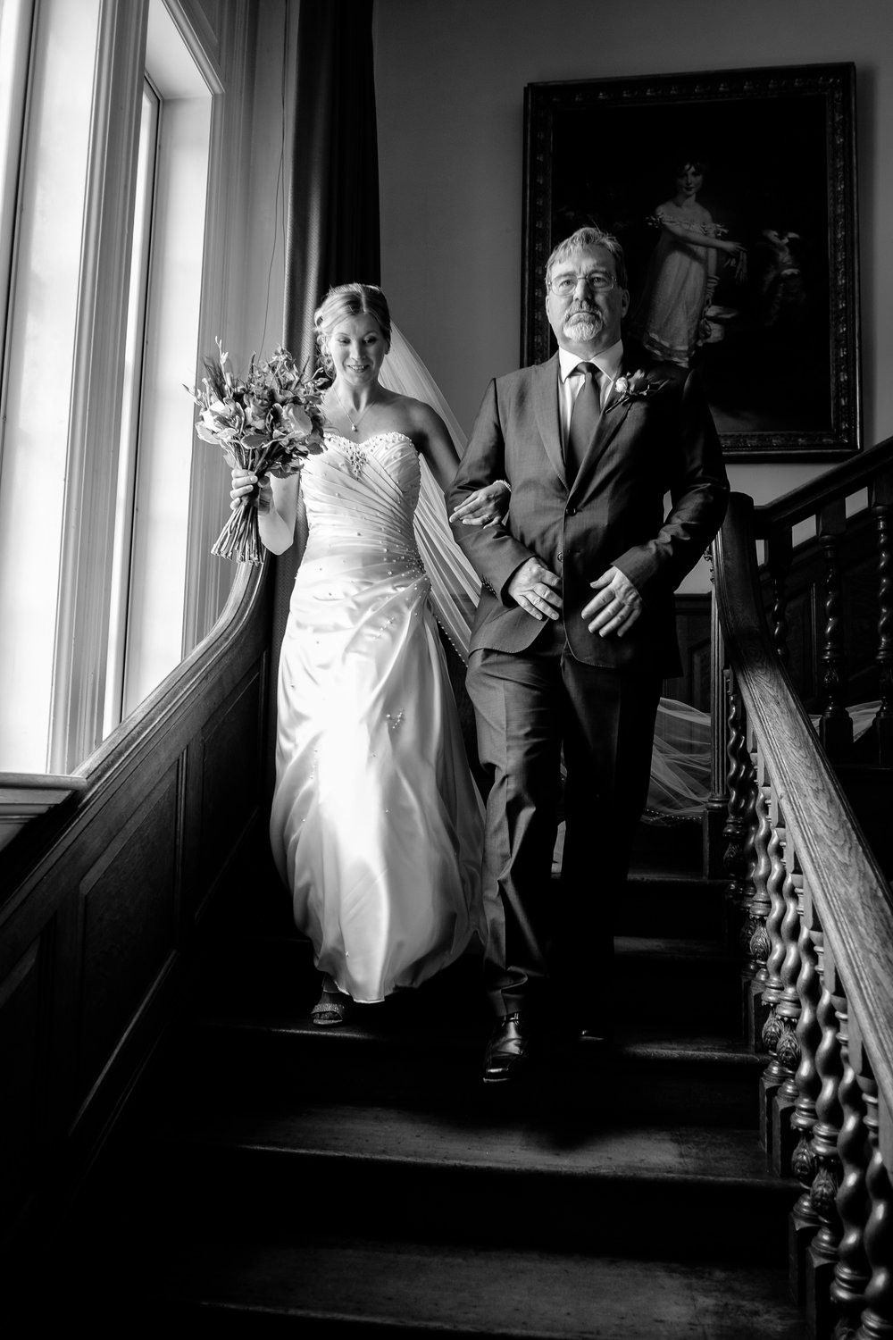 A bride with her father at a wedding at Poundon House, Near Bicester Oxfordshire