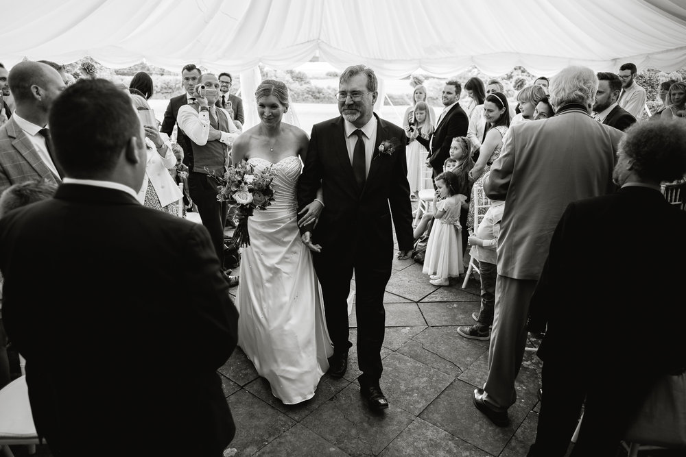 A groom sees his bride at a wedding at Poundon House, Near Bicester Oxfordshire