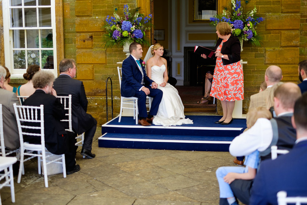 An outdoor wedding ceremony at a wedding at Poundon House, Near Bicester Oxfordshire