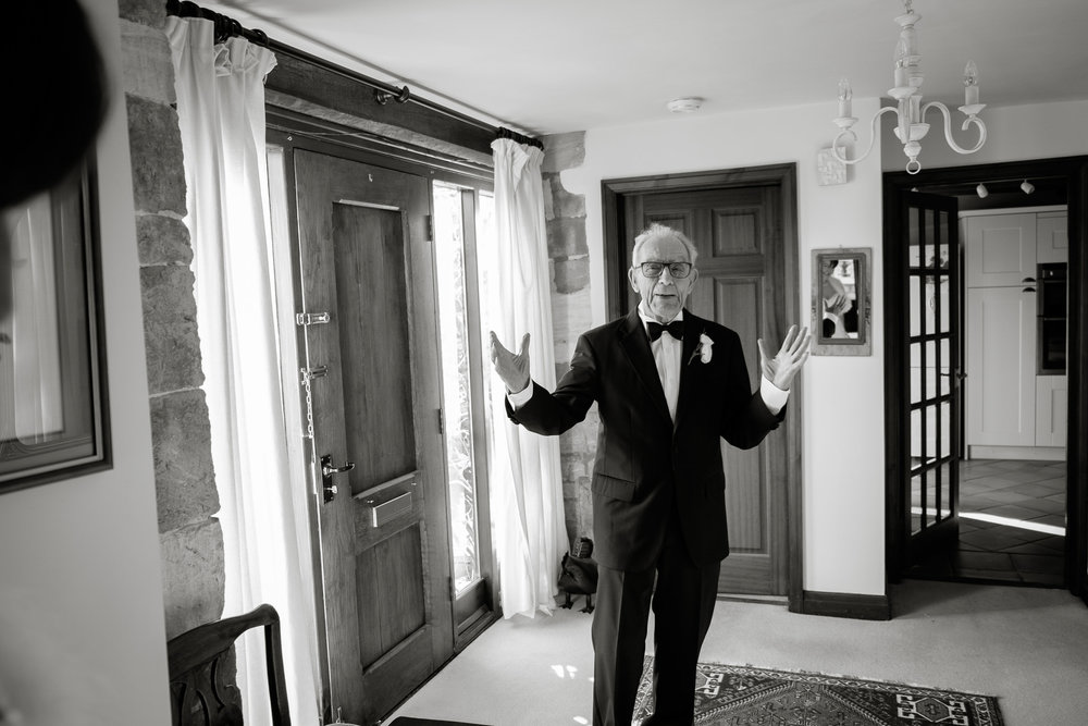 Father of the Bride seeing his daughter in her dress. Photography by Sam and Steve Photography