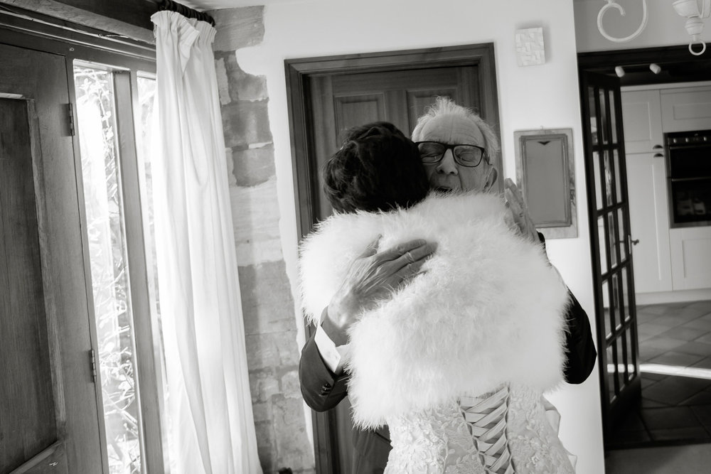 Father of the bride hugging his daughter, bride to be. By Sam and Steve Photography.