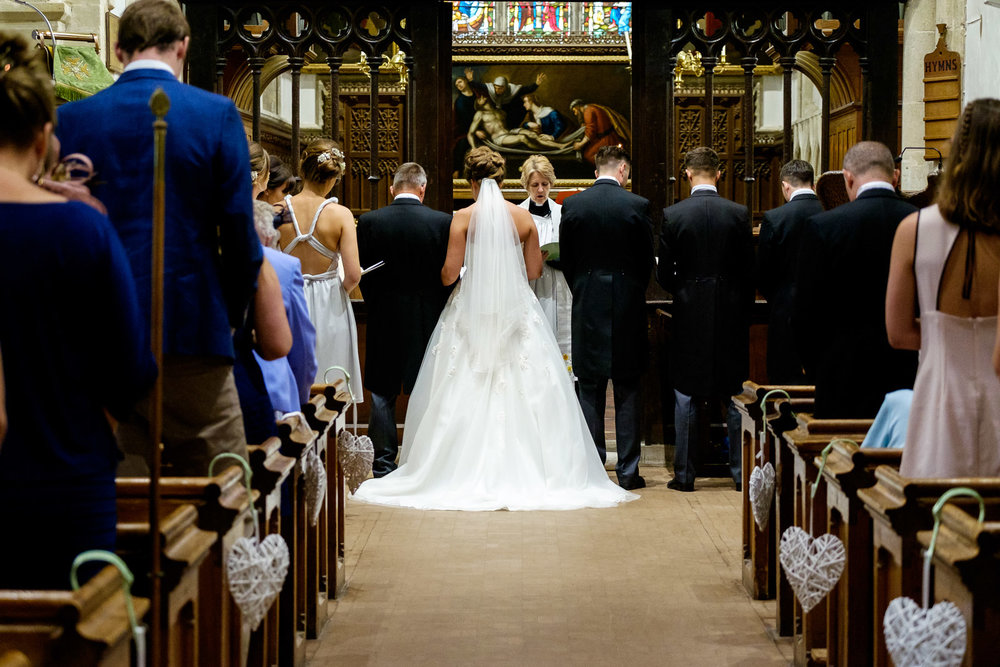 A vicar conducts a wedding at Chinnor Church. Photo by Sam and Steve Photography.
