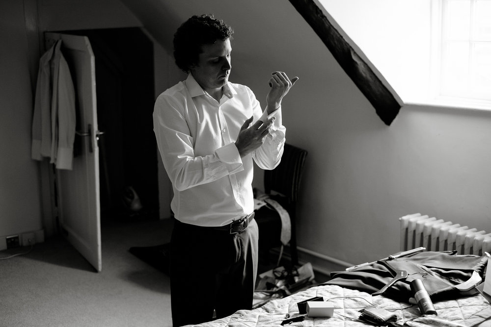 A groom getting ready before his wedding in Bicester. Photography by Sam and Steve Photography