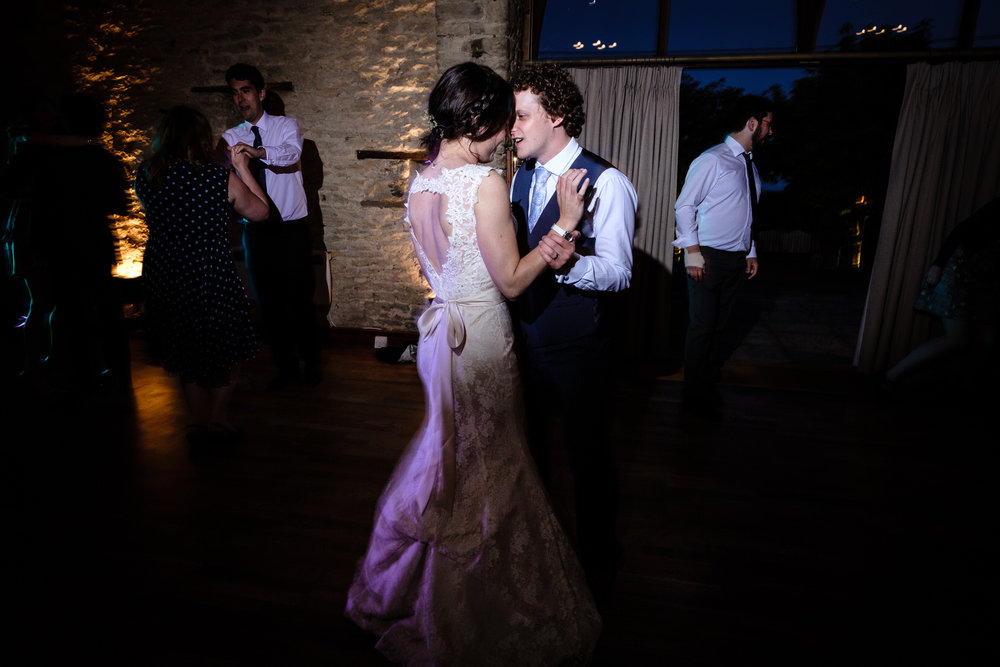 A bride and Groom Dancing at the Great Barn Wedding Venue, Aynho