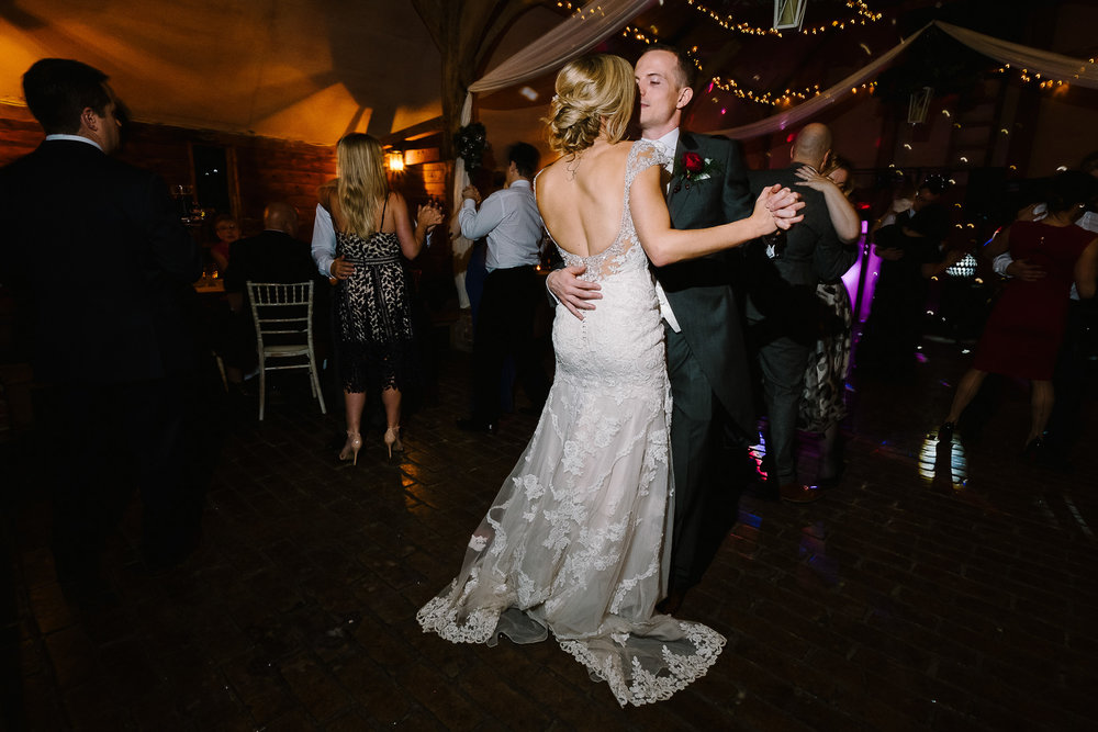 A bride and groom's first dance at Lains Barn wedding venue, Oxfordshire