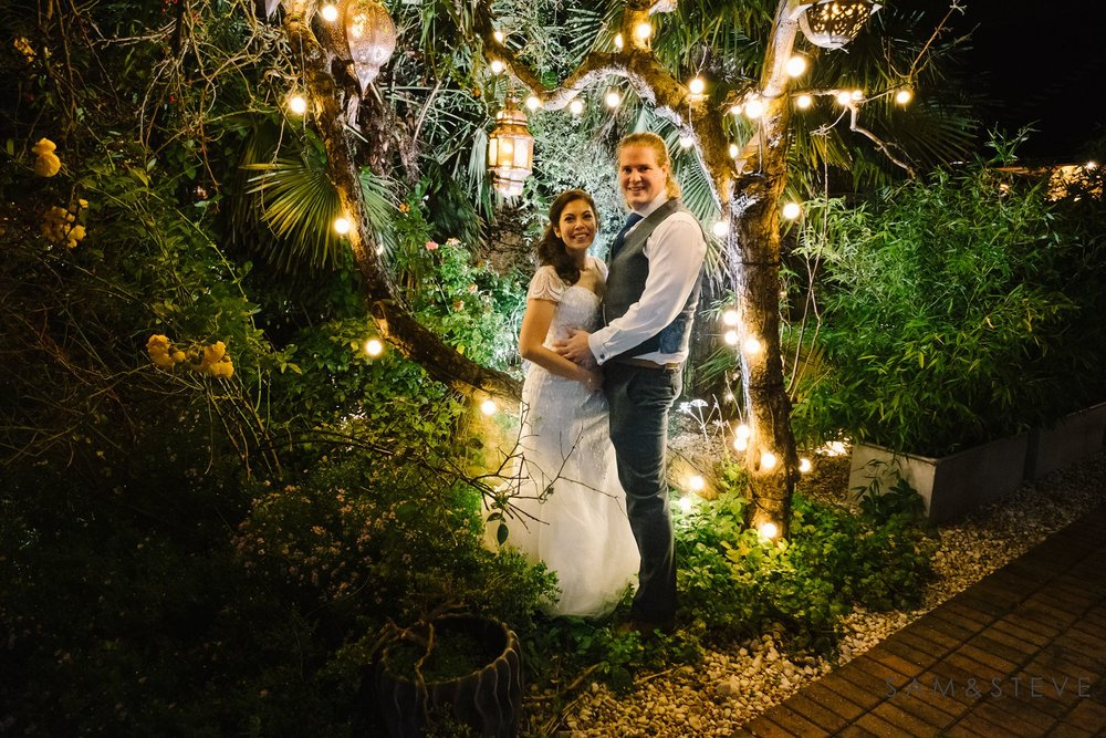 A bride and groom surrounded by fairylights at Crazy Bear, Stadhampton