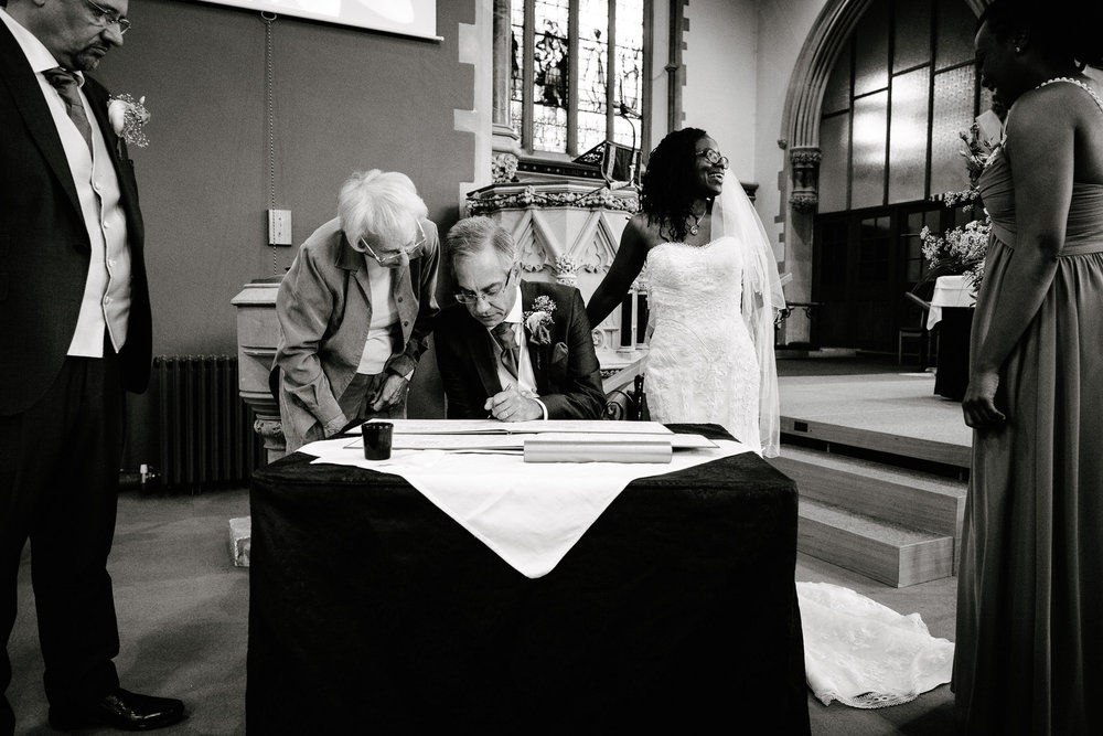 The Wedding of Thandie and Neil at Trinity Church, Abingdon, and Lains Barn
