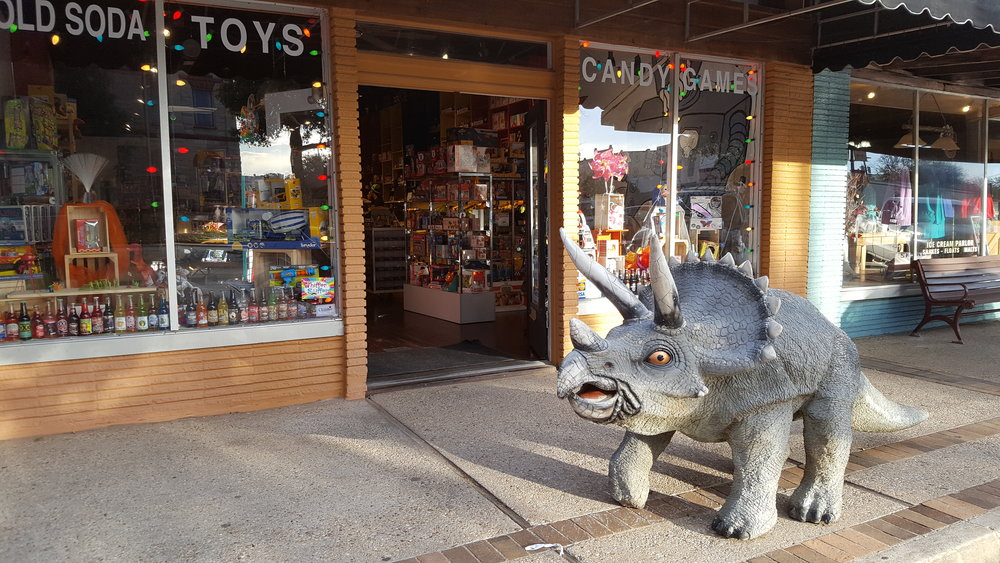 A vicious friendly Triceratops guarding the entrance to the Flash Candy and Toys store where I bought a root beer.