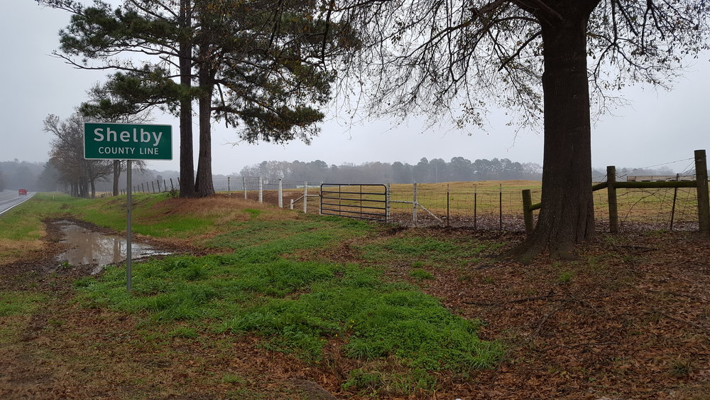 There is a nifty ranch entrance to the right of the Shelby county line.