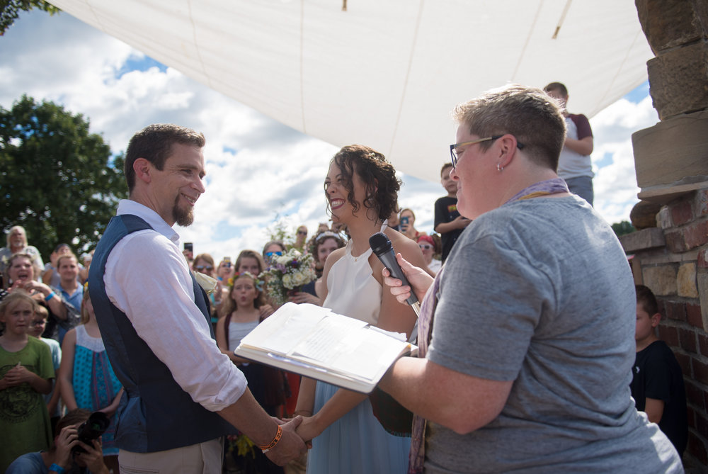 Tony and Anya Gonzales exchange wedding vows during the 20th Annual Ohio Pawpaw Fest on Sept. 15, 2018 at Lake Snowden in Albany, Ohio. Tony and Anya met at the Pawpaw Fest years ago.
