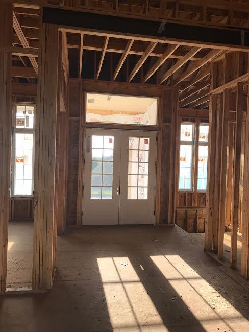 In the living room looking towards the foyer/front door