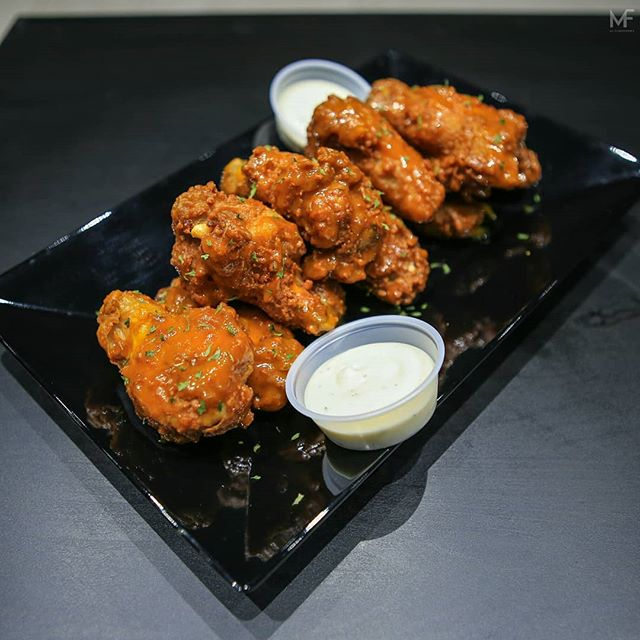 Great, succulent wings from @alphaastoria. Check them out some time!