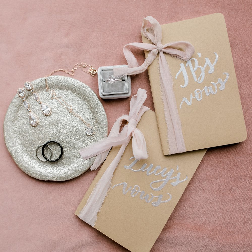 Lucy+JB Wedding vow books with rings.jpg