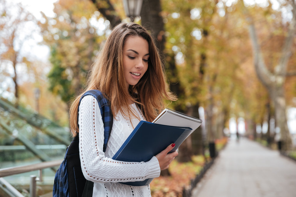 graphicstock-beautiful-young-woman-with-backpack-and-notebooks-walking-in-park_S_XJCYI3x.jpg
