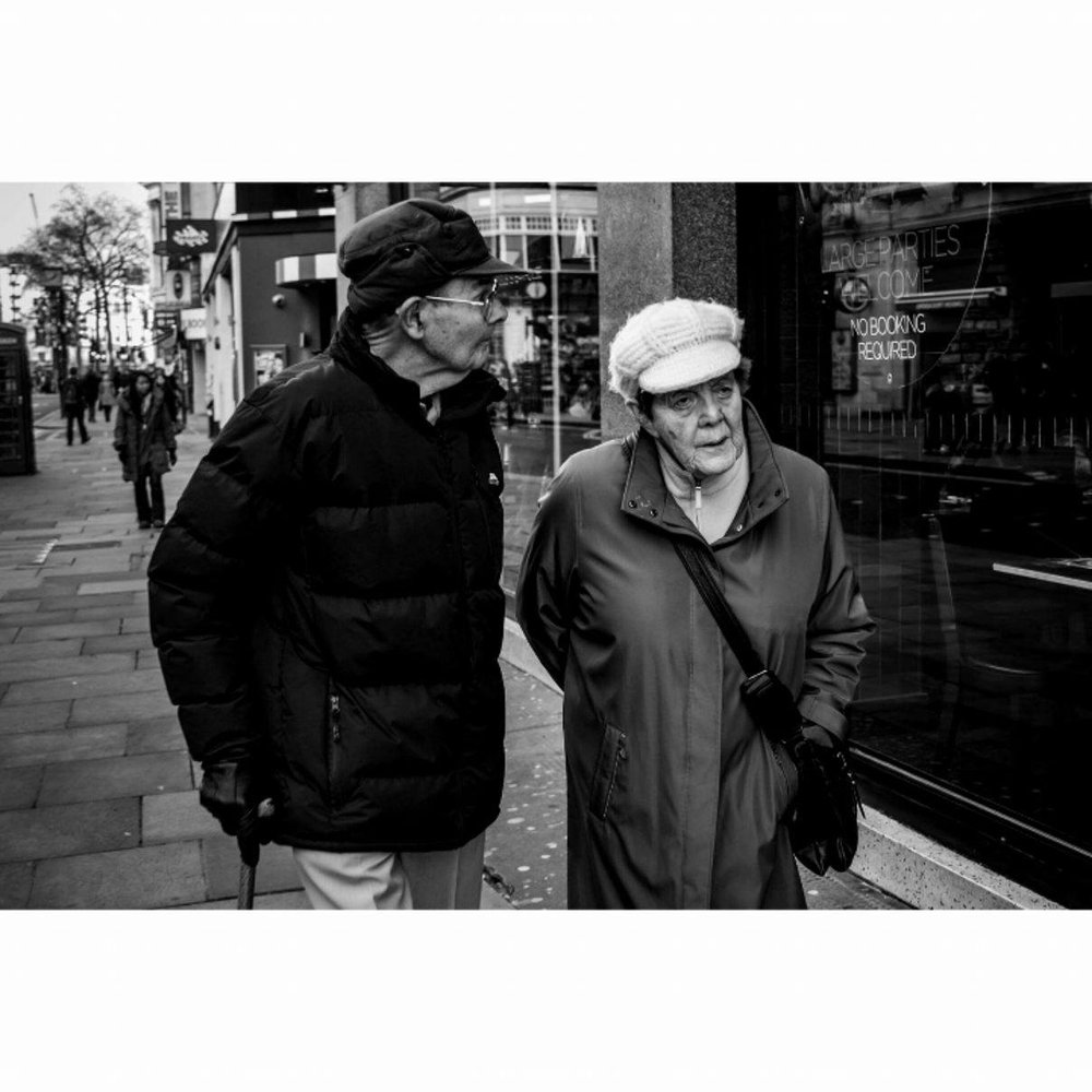 Old couple in Leicester Square, London - January 2017