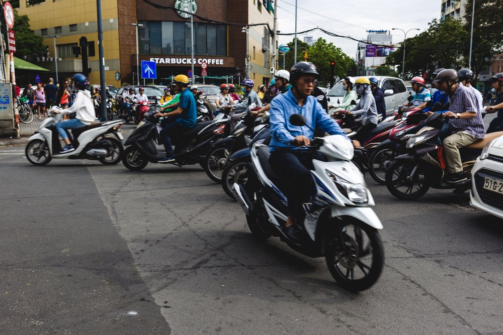 Traffic in HCMC, December 2017   Most cities in Southeast Asia are crippled by heavy traffic. Motorbikes are the main means of transportation due to smaller sizes, costs, and higher flexibility.