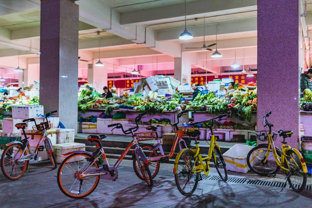 Bike-sharing and street markets   Despite the heavy pollution and the persistent consumption of fossil fuels, China has stepped up its efforts to tackle climate change and go green. Bike-sharing is a huge phenomenon in the country.