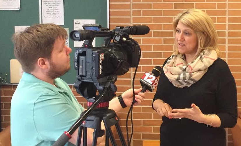 Allen Clayton of WBOY TV interviews Karan Ireland of WV SUN about why FirstEnergy's deal is so bad for West Virginians on Tuesday at The Caperton Center in Clarksburg. Click the photo to watch the report.