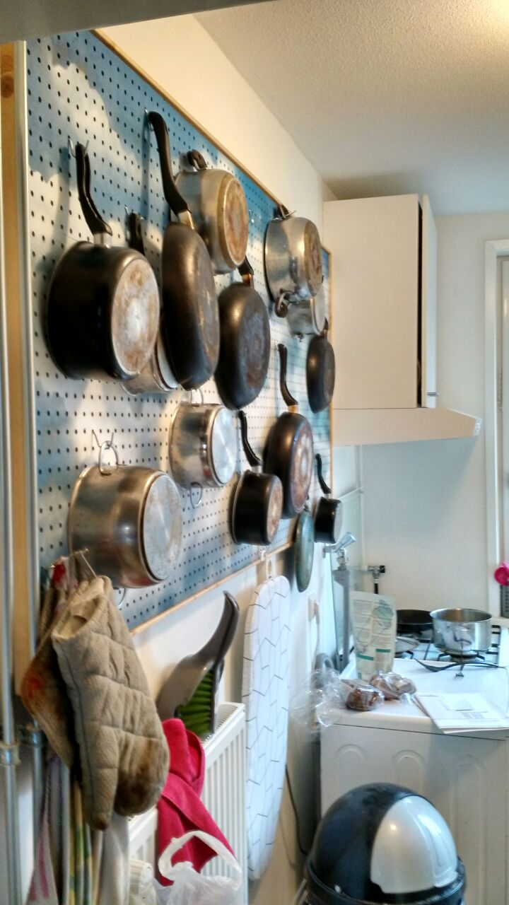 DIY kitchen pegboard pots pans graffiti spraypaint
