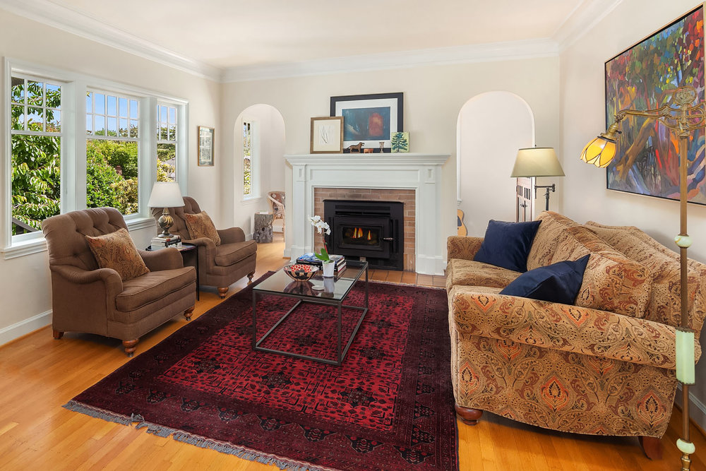Archways hide a sunny spot behind the fireplace wall.