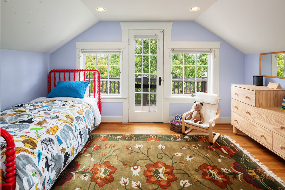 Bedroom #3, sweet as a summer cottage, with a private deck.