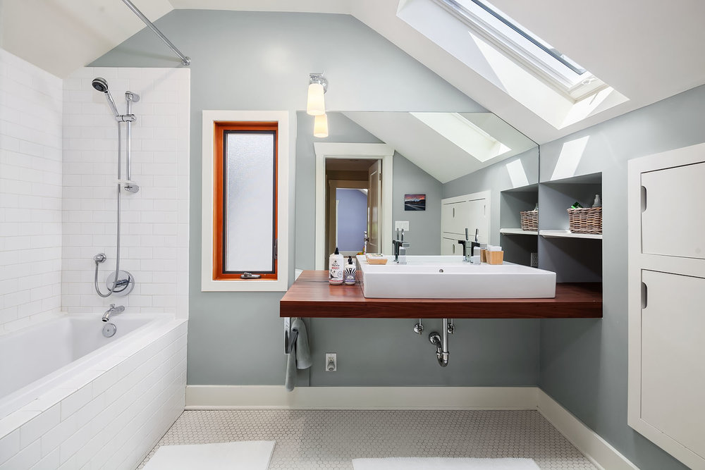 Upstairs, a touch more modern, with built-ins and a deep soaking tub.