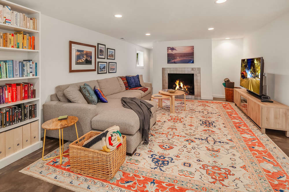A lovely fireplace and heated concrete floors throughout.