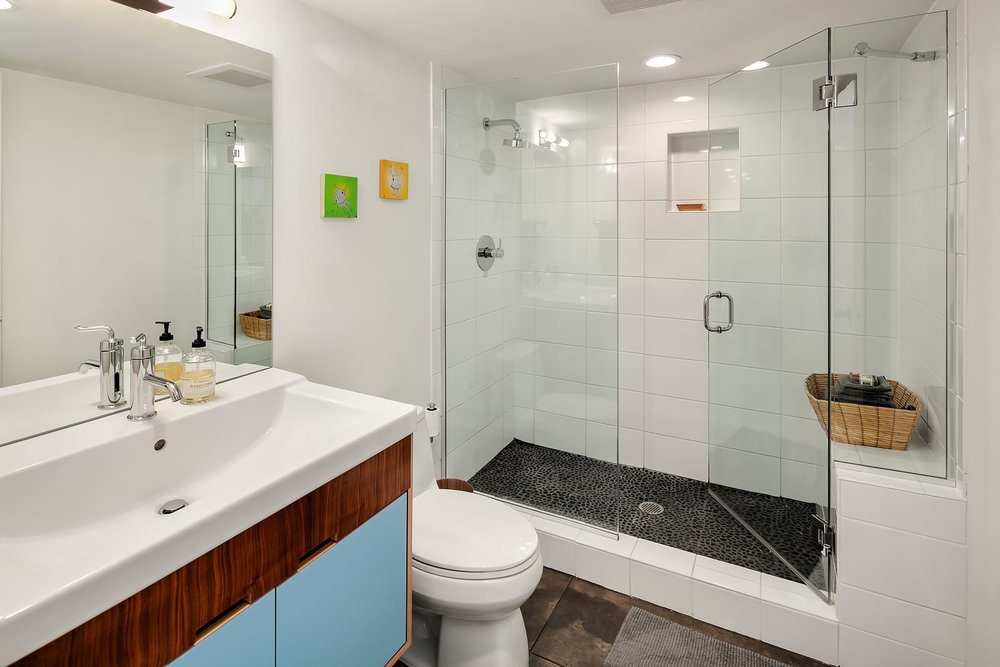 The perfect modern bath to serve the lower level.
