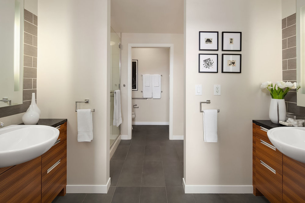 Three distinct zones + heated floors make the master bath a suite of its own.