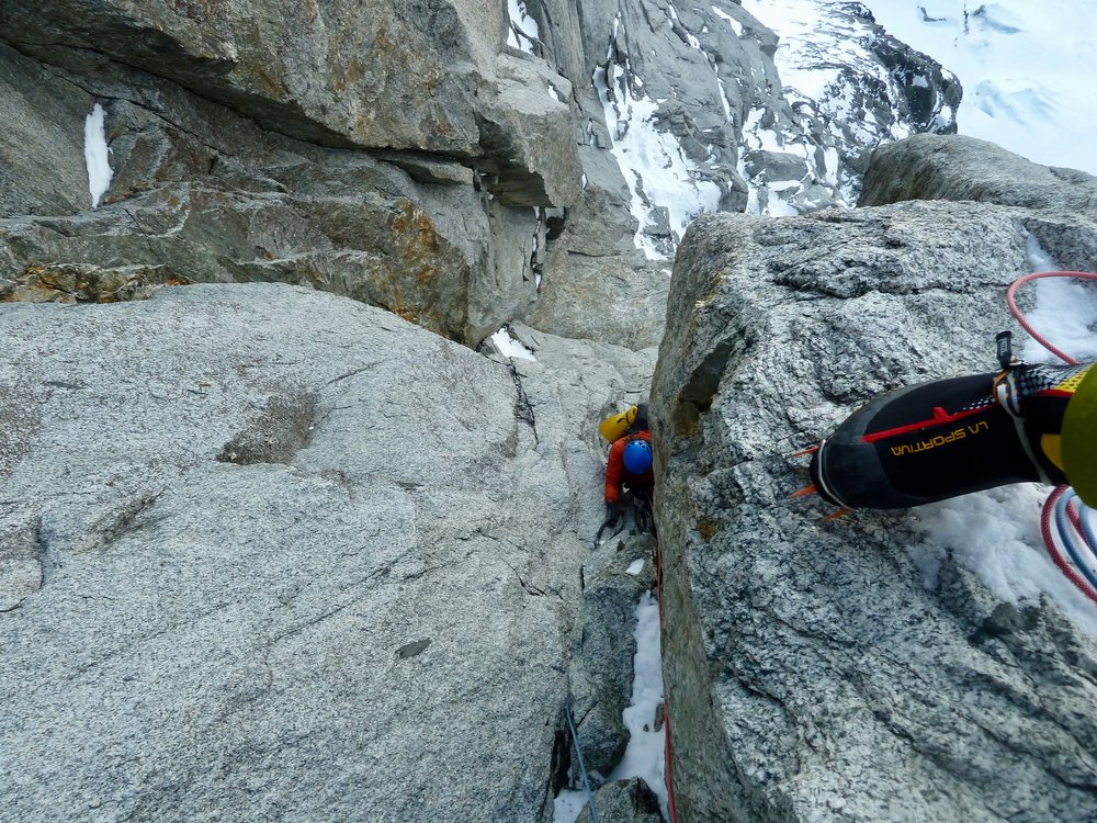 Kim seconding the first crux on the leseuer route, Le dru