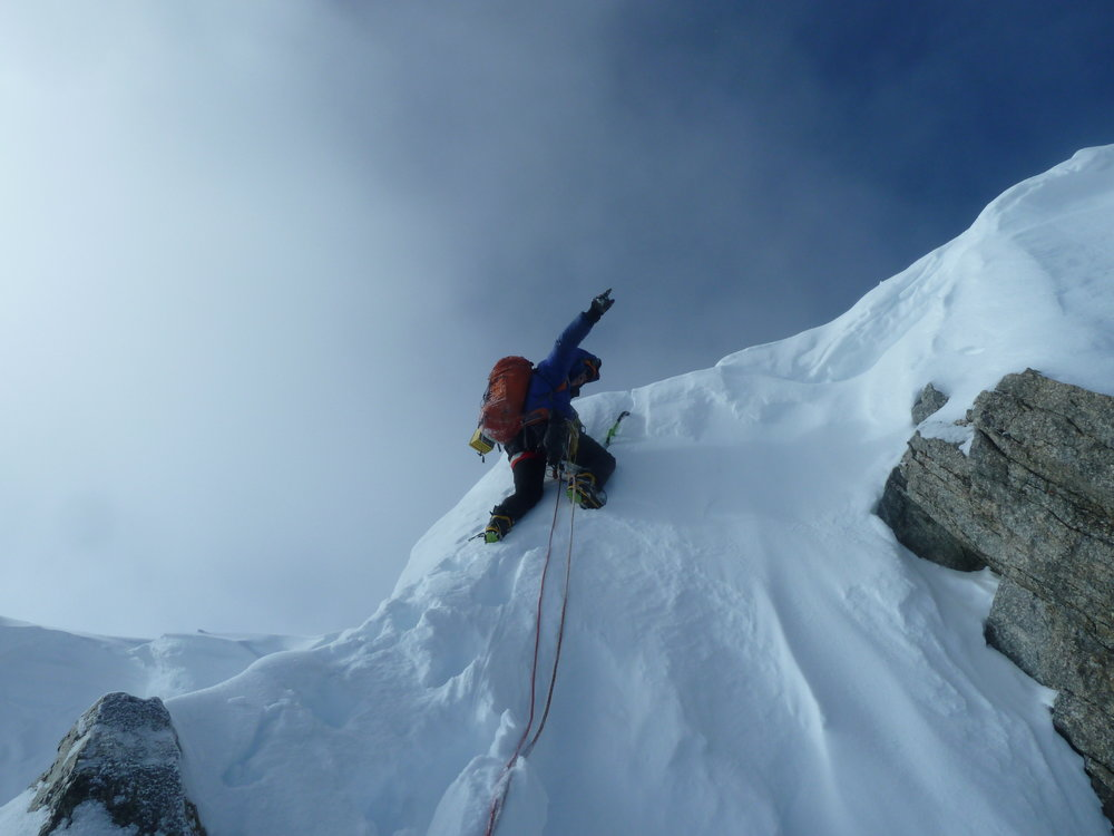 Pete Graham tops out after a winter ascent of the Walker Spur, Grandes Jorasses.