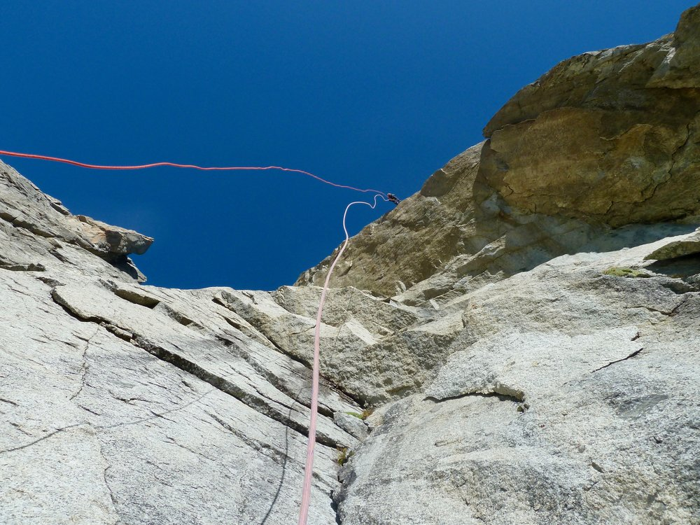 Tony abseiling over the 'wake up' roof to the start of the American Route.