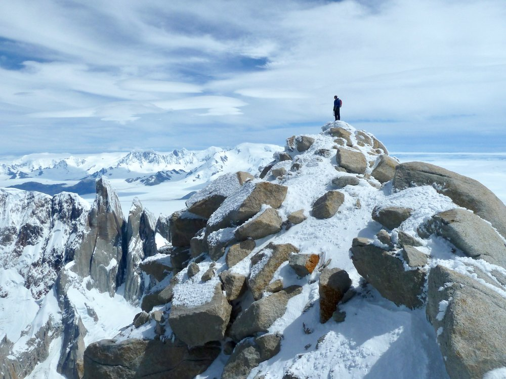 Tony Stone on the summit of Fitzroy. Cerro Torre is down to the left, and the Patagonian icecap stretches into the distance.