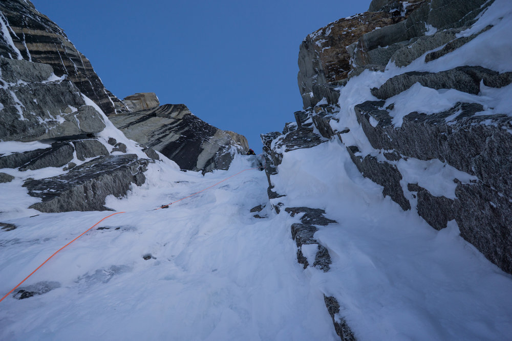 Uisdean firing the Breakfast pitch on the east face route.