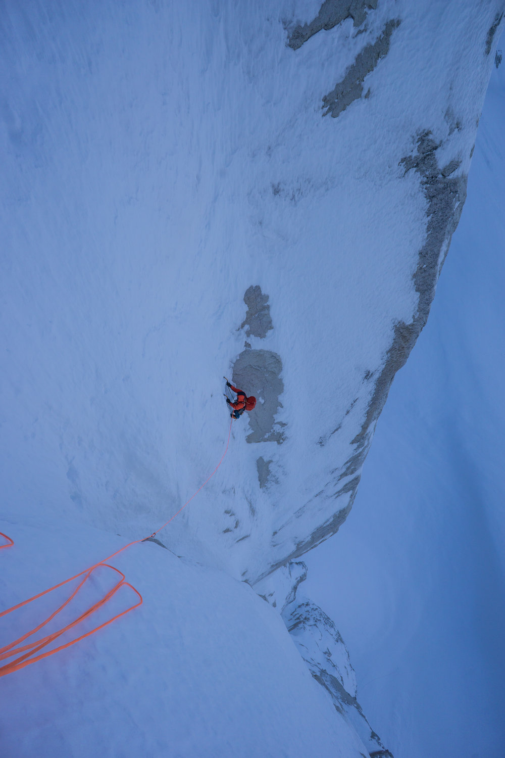 Uisdean seconding a 'don't fall off' pitch of steep nevé on our north face attempt.