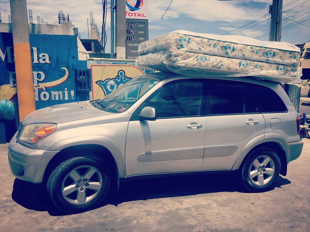 Ruby the RAV4 full of mattresses, a refrigerator, and other supplies for our home.