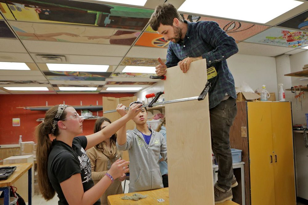 Emanuel of Citizen Carpentry teaches students to build art displays at Parkway North HS