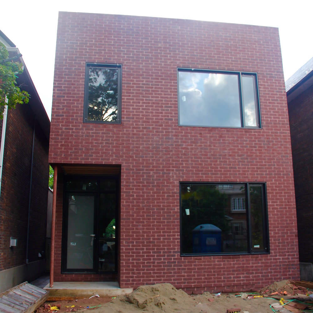 Front facade with entry door system, and combination fixed and tilt & turn windows