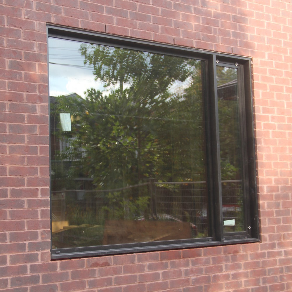 Combination fixed window with tilt and turn vent