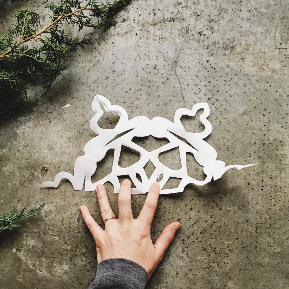 DIY Giant Snowflake wall decor for the holidays how to make a paper snowflake