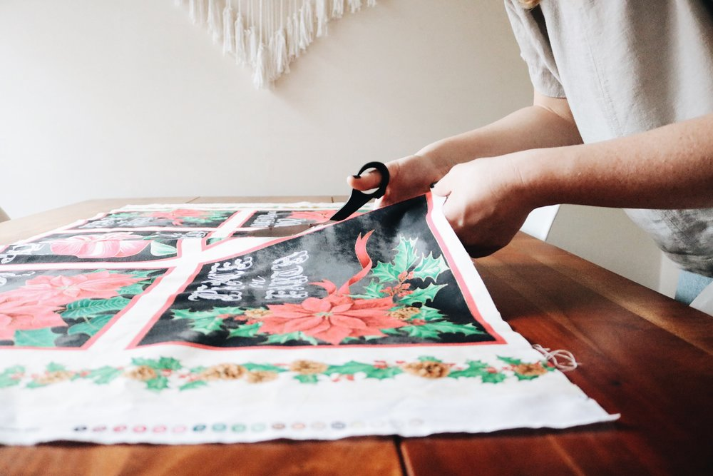 Cutting Christmas fabric for DIY appliqué turtlenecks