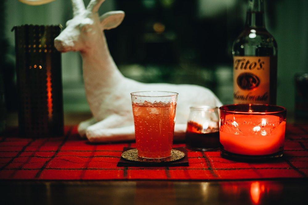 Tito's Eden on Earth - 2 oz Tito's Handmade Vodka2 oz orange juice1 oz St. Germain Liquor1/2 oz Aperol1/2 oz sparkling wineOrange peel